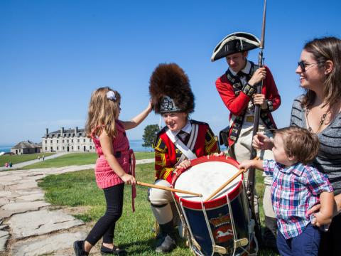 Interacting with actors dressed as soldiers during Old Fort Niagara's War of 1812 Encampment