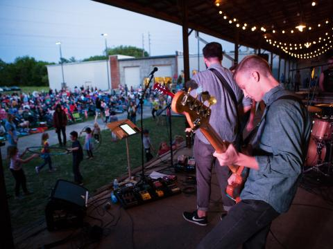 A band performing during Lowe Mill ARTS & Entertainment Concerts on the Dark